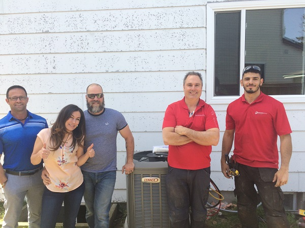 Homeowners-and-OHS-installation-team